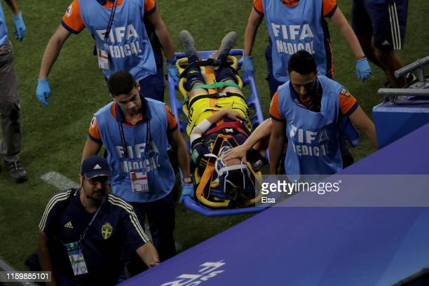 Kosovare Asllani of Sweden is carried off the pitch on a stretcher after receiving medical treatment during the 2019 FIFA Women's World Cup France...