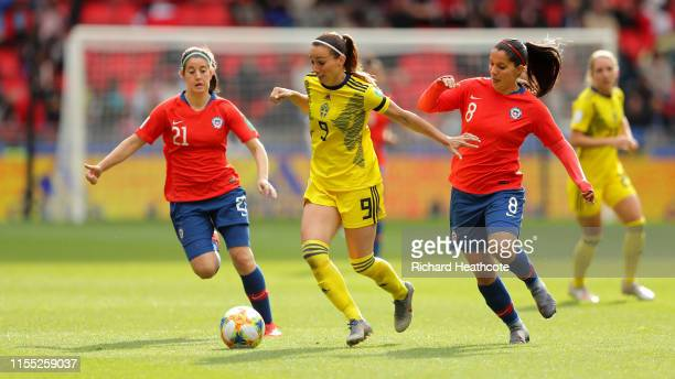 Kosovare Asllani of Sweden is challenged by Rosario Balmaceda of Chile and Karen Araya of Chile during the 2019 FIFA Women's World Cup France group F...