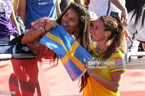 Kosovare Asllani of Sweden poses for a photo with a fan after a loss in the FIFA Women's World Cup Canada 2015 round of 16 match between Germany and...