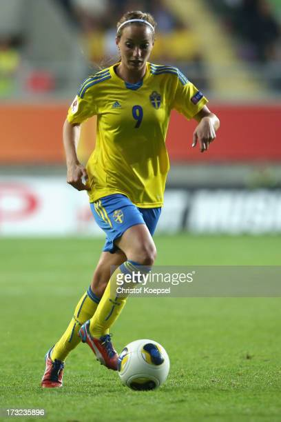 Kosovare Asllani of Sweden runs with the ball during the UEFA Women's EURO 2013 Group A match between Sweden and Denmark at Gamla Ullevi Stadium on...