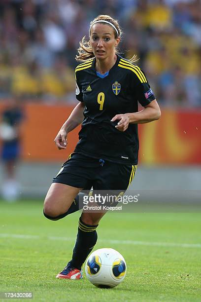 Kosovare Asllani of Sweden runs with the ball during the UEFA Women's EURO 2013 Group A match between Finland and Sweden at Gamla Ullevi Stadium on...