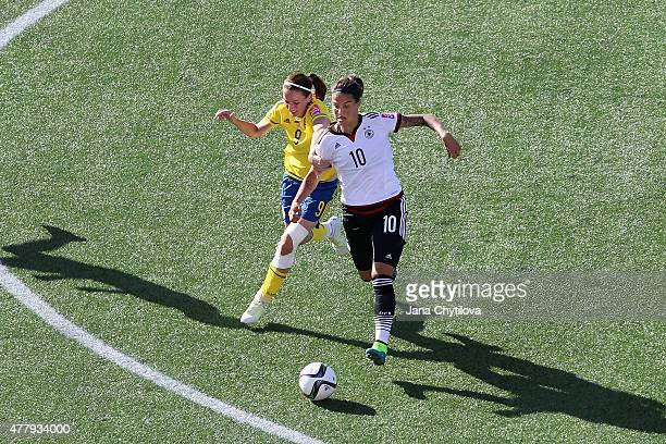 Kosovare Asllani of Sweden tries to catch Dzsenifer Marozsan of Germany during the FIFA Women's World Cup Canada 2015 round of 16 match between...