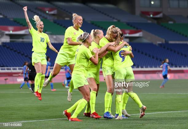 Kosovare Asllani of Team Sweden celebrates with teammates after scoring their side's third goal from the penalty spot during the Women's Quarter...