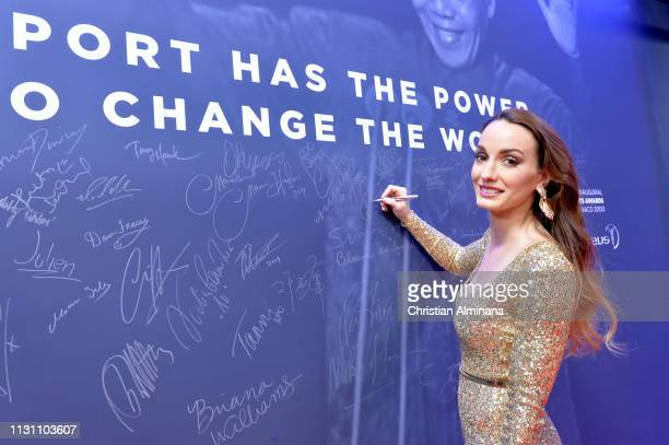 Kosovare Asllani signs the Nelson Mandela wall during the 2018 Laureus World Sports Awards at Salle des Etoiles Sporting MonteCarlo on February 27...