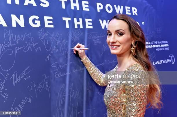 Kosovare Asllani signs the Nelson Mandela wall during the 2019 Laureus World Sports Awards on February 18 2019 in Monaco Monaco
