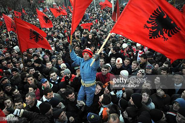 Kosovars hold flags as they celebrate the independence of Kosovo in the capital Pristina on February 17 2008 Kosovo's parliament Sunday declared the...