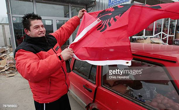 A Kosovo Albanian man covers his car with an Albanian flag February 16 2008 in Pristina Serbia Kosovo Albanians are rabidly proAmerican after the US...