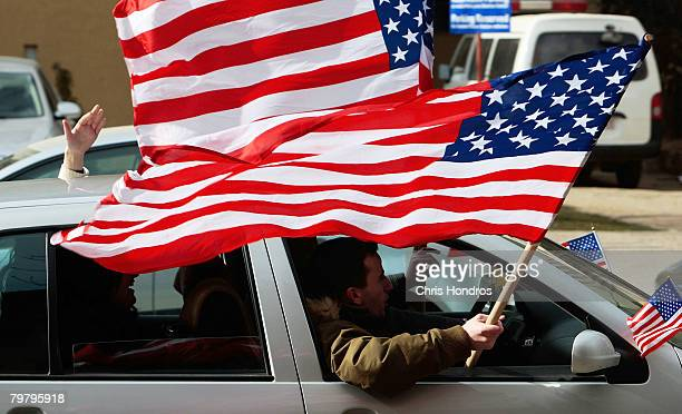 A Kosovo Albanian man waves American flags out of a car February 16 2008 in Pristina Serbia Kosovo Albanians are rabidly proAmerican after the US led...