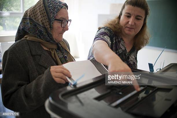A Kosovo Albanian woman casts her ballot at a polling station in the village of Llukar on June 8 during Kosovo's parliamentary elections Kosovo voted...