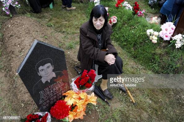 A Kosovo Albanian Woman Cries In Front Of Her Sons Grave -4099