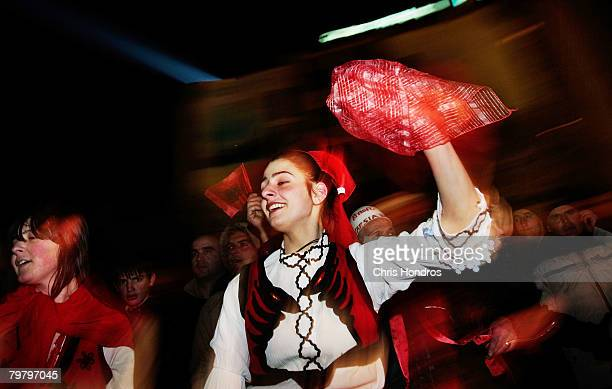 Kosovo Albanian woman in traditional dress performs a dance in the heart of downtown February 16 2008 in Pristina Serbia Pristina is buzzing with...