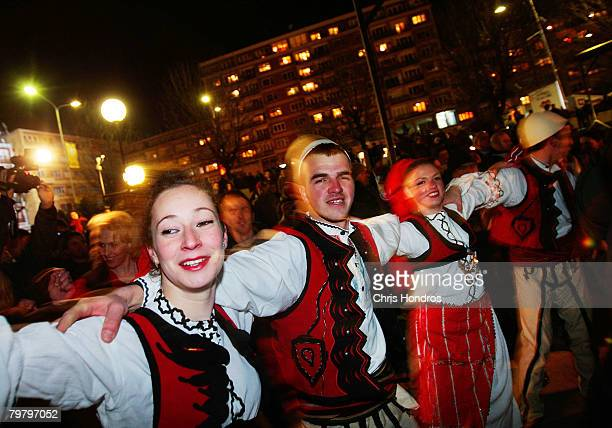 Kosovo Albanian women and men perform a traditional dance in the heart of downtown February 16 2008 in Pristina Serbia Pristina is buzzing with...