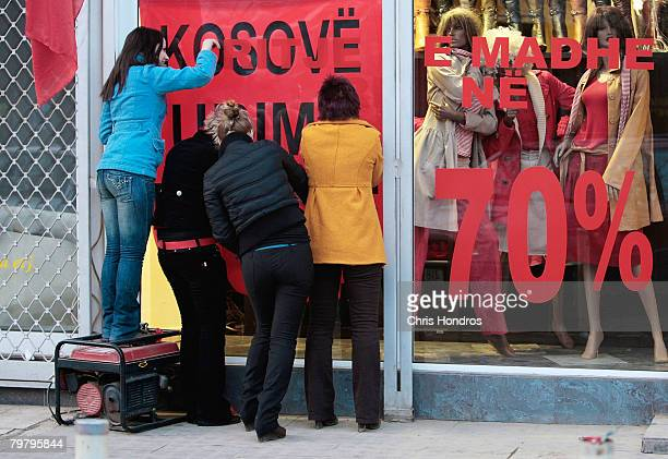 Kosovo Albanian women hang signs celebrating independence with a clothing sale February 16 2008 in Pristina Serbia The Kosovo province of Serbia have...