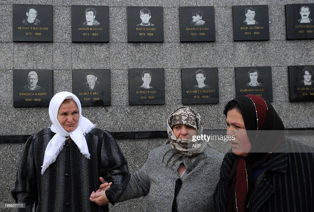 Kosovo Albanian women stand in front of commemorative plates as they pay tribute to relatives during the 14th anniversary of the Recak massacre on January 15, 2013. In 1999, forty-five Albanian civilians were killed by Serb forces, in the village of Recak. The massacre, one of the bloodiest that occurred in the Kosovo crisis, led to massive international pressure on Serbia to stop their ethnically motivated killings of civilian Albanians and to a NATO led air campaign that ousted Serbian security forces from Kosovo.