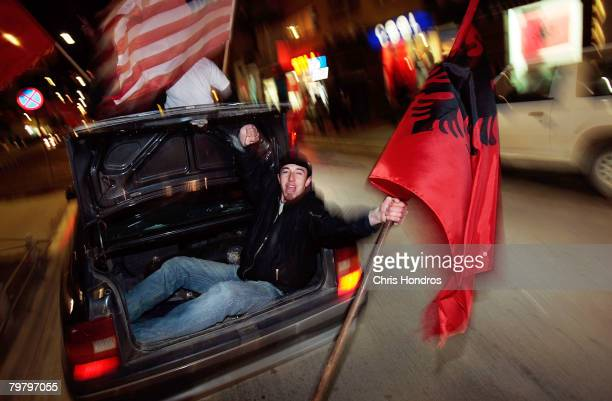 Kosovo Albanian youths wave Albanian and American flags from their car February 16 2008 in Pristina Serbia Pristina is buzzing with excitement as...