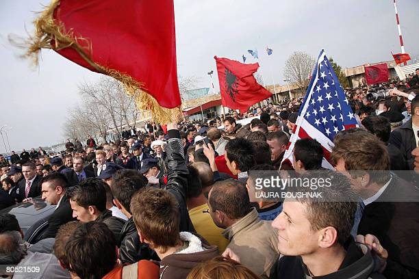 Kosovo Albanians follow the car of former prime minister and leader of the Alliance for the Future of Kosovo party Ramush Haradinaj upon his arrival...