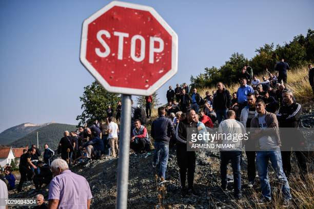 Kosovo Albanians gather around a barricade as they block on September 9 2018 access to a village due to be visited by Serbian President on the main...
