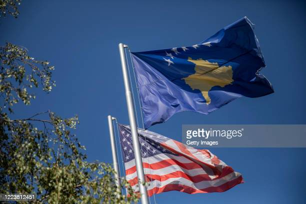 June 30, 2020: Kosovo and American flags wave in city center on June 29, 2020 in Pristina, Kosovo. President Hashim Thaci, who was the former...