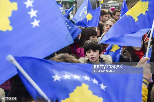 Kosovo children wave Kosovo flags in the main square in Pristina on February 13 ahead of the 10th anniversary of Kosovo's Independence Kosovo...