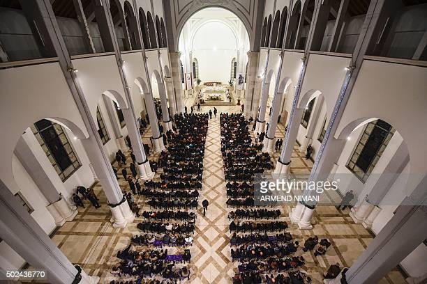 Kosovo Christians attend a Christmas eve mass at the Mother Teresa Cathedral in Pristina on December 24 2015 AFP PHOTO/ ARMEND NIMANI / AFP / ARMEND...