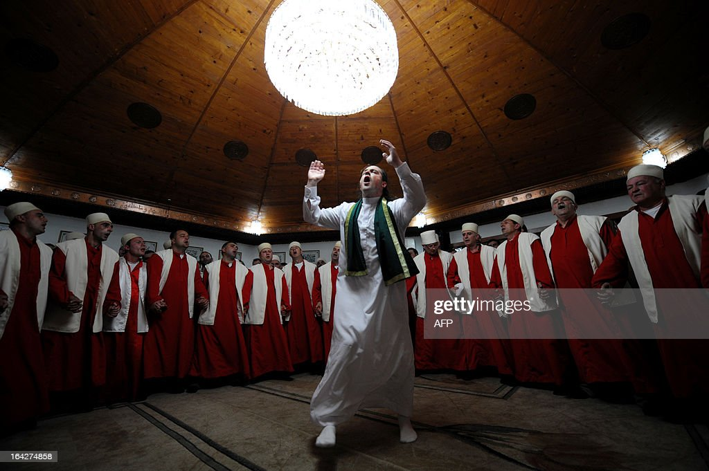 Kosovo dervishes, adepts of Sufism, a mystical form of Islam that preaches tolerance and a search for understanding, take part in a ceremony in the prayer room in the town of Gjakova on March 21, 2013. The Kosovo dervish community carries on centuries-old mystical practices, such as self-piercing with needles and knives as a way to earn salvation and find the path to God.