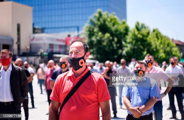 Kosovo Liberation Army veteran with a face mask depicting the KLA Logo takes part in a protest in Pristina on July 9, 2020 against the indictments of...