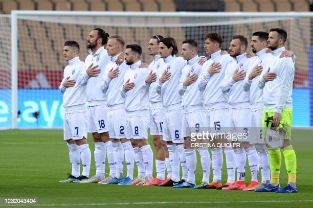 Kosovo players listen to the national anthem before the FIFA World Cup Qatar 2022 qualification football match between Spain and Kosovo at La Cartuja...