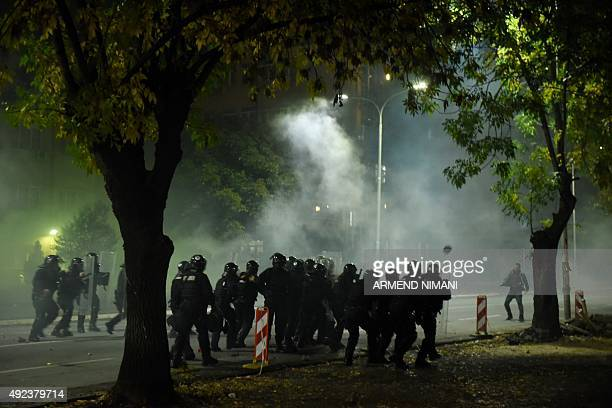 Kosovo police fire tear gas at supporters of opposition MP Albin Kurti during clashes in central Pristina on October 12 2015 Kurti was arrested hours...