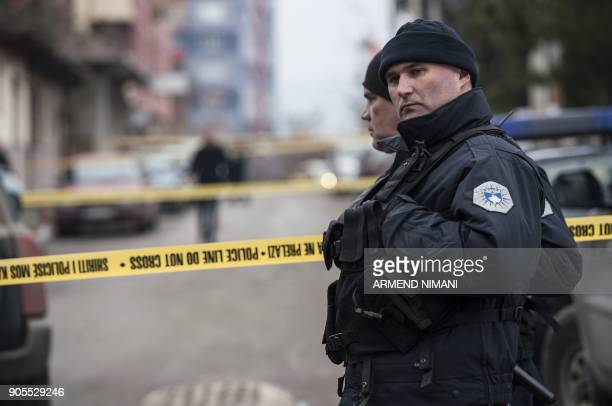 Kosovo police officers secure the area where leading Kosovo Serb politician Oliver Ivanovic was killed in a brazen driveby shooting in Mitrovica on...