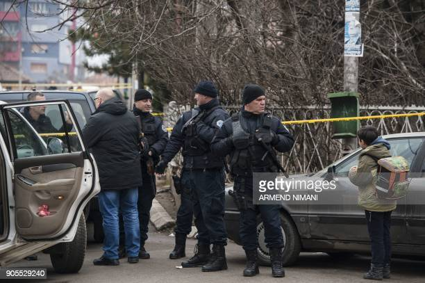 Kosovo police officers secure the area where the leading Kosovo Serb politician Oliver Ivanovic was killed in a brazen driveby shooting in Mitrovica...