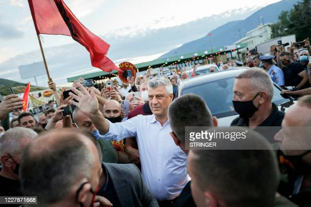 Kosovo President Hashim Thaci greets his supporters and Kosovo Liberation Army war veterans who gathered to welcome him upon his arrival at the...
