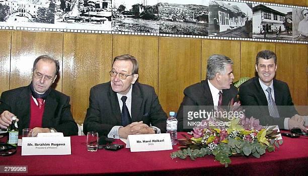 Kosovo President Ibrahim Rugova UN chief in Kosovo Finnish Harri Holker Kosovo Prime Minister Bajram Rexhepi and former Kosovo Albanian rebel leader...