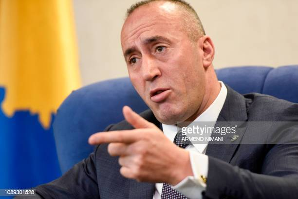 Kosovo Prime Minister Ramush Haradinaj speaks during an interview with the AFP in Pristina on January 25 2019 A deal between Serbia and Kosovo is...