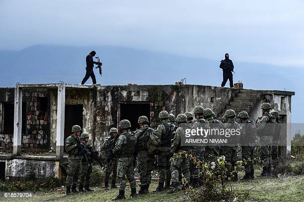 Kosovo Security Force and and US soldiers take part in a field exercise in the village of Nashec near the town of Prizren on October 27 2016 Eight...