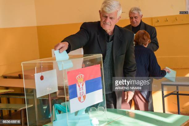 A Kosovo Serb man casts his ballot at the polling station in the town of Gracanica on April 2 2017 Serbians head to the polls to elect a new...