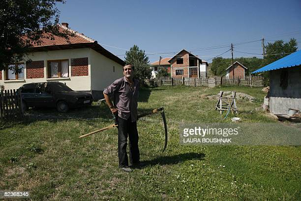HAJDARI KOSOVOINDEPENDENCEDIPLOMACYENCLAVE Kosovo Serb Vojslav Jovic stands in front of his house after working in the field in the village of...