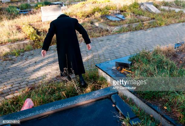 A Kosovo Serb woman visits the graves of her relatives at a cemetery in the ethnically divided town of Mitrovica on November 4 during All Soul's Day...