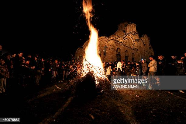 Kosovo Serbs gather around a bonfire at the medieval monastery of Gracanica on the eve of the Orthodox Christmas on January 6 2014 AFP PHOTO / ARMEND...