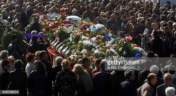 Kosovo Serbs mourn over the coffins of their relatives during a memorial service at the Orlovaca cemetery in Belgrade 14 October 2006 UN authorities...