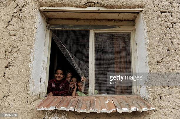 Kosovominoritiesrights Ashkali children look out a window in the village of Dubrava near the town of Urosevac on September 25 2009 The Ashkali ethnic...