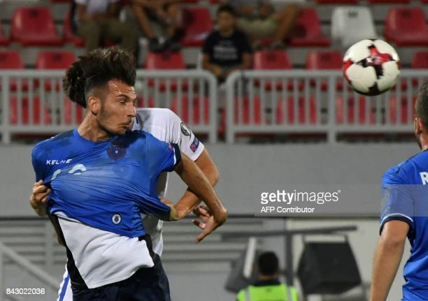 Kosovo's defender Leart Paqarada heads the ball during the FIFA World Cup 2018 qualification football match between Kosovo and Finland at Loro Borici...