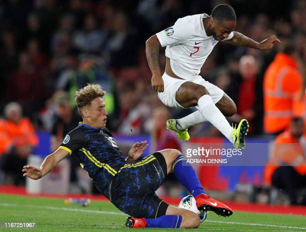 Kosovo's defender Mergim Vojvoda vies with England's midfielder Raheem Sterling during the UEFA Euro 2020 qualifying Group A football match between...