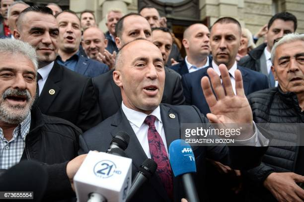CORRECTION Kosovo's former Prime Minister Ramush Haradinaj speaks to the media as he leaves the Court in Colmar eastern France on April 27 following...