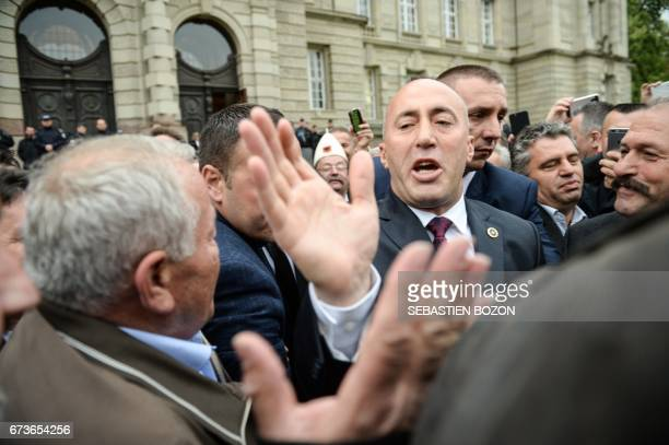 CORRECTION Kosovo's former Prime Minister Ramush Haradinaj waves to his supporters as he leaves the Court in Colmar eastern France on April 27...