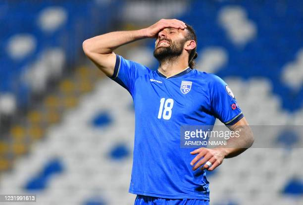 Kosovo's forward Vedat Muriqi reacts during the FIFA World Cup Qatar 2022 qualification Group B football match between Kosovo and Sweden at the Fadil...