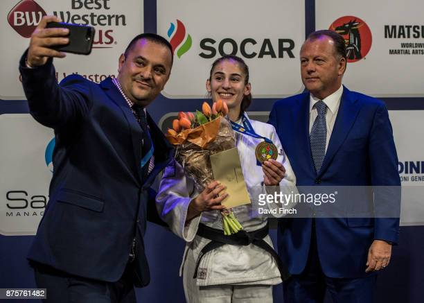 Kosovo's judo coach Driton Kuka takes a 'selfie' picture of Kosovo's u57kg gold medalist together with the International Judo Federation's President...