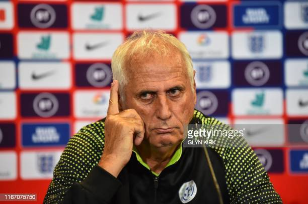 Kosovo's manager Bernard Challandes gives a press conference at St Mary's Stadium in Southampton southern England on September 9 ahead of their Euro...