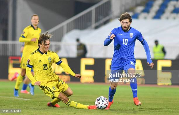 Kosovo's midfielder Arber Zeneli fights for the ball against Sweden's midfielder Kristoffer Olsson during the FIFA World Cup Qatar 2022 qualification...