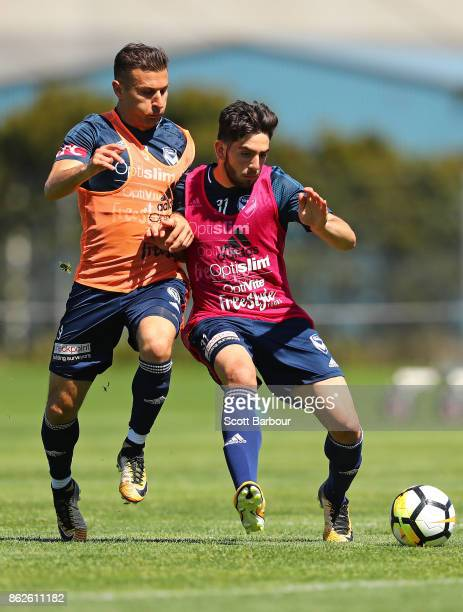 Kosta Barbarouses and Christian Theoharous of the Victory compete for the ball during a Melbourne Victory ALeague training session at Gosch's Paddock...