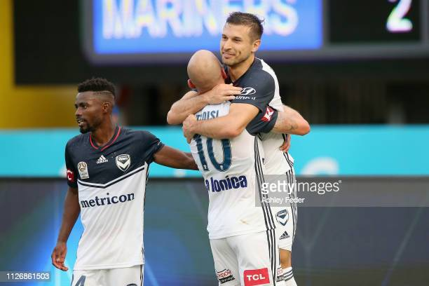 Kosta Barbarouses of Melbourne Victory celebrates his goal with team mates during the round 17 ALeague match between the Central Coast Mariners and...